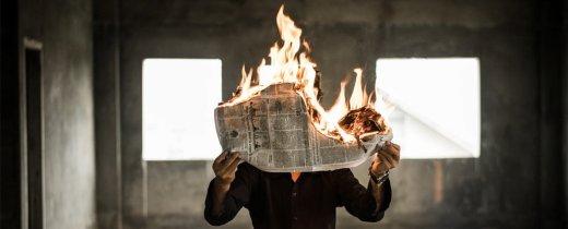 fake_news_burning_newspaper.jpg